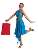 Happy Woman with Shopping Bag. Young happy blonde woman in a fancy dress with shopping bag jumping against a white background Royalty Free Stock Photo