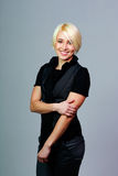 Young happy blonde woman standing Royalty Free Stock Image