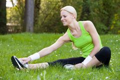 Young Happy Blonde Woman Stretching Leg Royalty Free Stock Photo