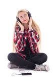 Young happy blondie woman listening music in earphones isolated Stock Photos