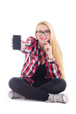 Young happy blondie woman sitting and showing mobile phone in he Royalty Free Stock Photos