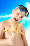 Young happy boy having fun on tropical beach Royalty Free Stock Images