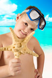 Young happy boy having fun on tropical beach Stock Images