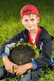 Young happy boy hold sunflower in a garden Stock Photos