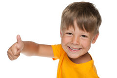 Young happy boy holds his thumb up Stock Photography