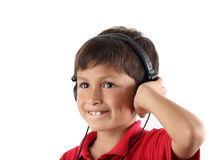Young happy boy listening to headphones Royalty Free Stock Photos