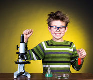 Young happy boy performing experiments. Little scientist. Stock Images
