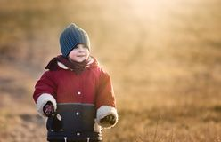 Young happy boy playing outdoor at spring Royalty Free Stock Photos
