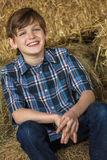 Young Happy Boy Smiling on Hay Bales Stock Images