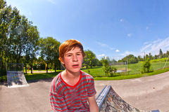Young happy boy sweating and exhausted from sports Royalty Free Stock Images