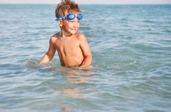 Young happy boy in water. Young happy boy playing in water Royalty Free Stock Photos