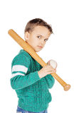Young happy boy with wooden baseball bat and ball isolated on wh Royalty Free Stock Photo