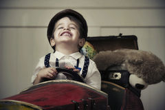 Young happy boy in wooden car Stock Photo