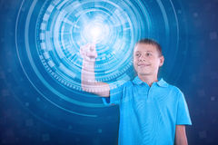Young happy boy working with digital virtual screen Royalty Free Stock Image