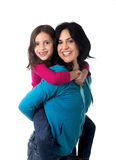 Young happy Brazilian mother carrying on her back  little daughter Stock Photo
