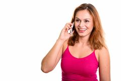 Young happy Brazilian woman smiling while talking on mobile phon royalty free stock photo