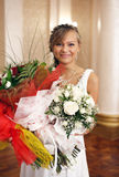 Young happy bride with flowers Royalty Free Stock Photography