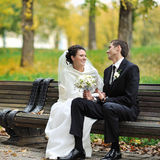 Young happy bride and groom in an autumn park together Stock Photography