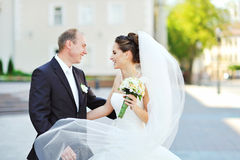 Young happy bride and groom having a good time in an old town Royalty Free Stock Image