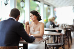 Young happy bride and groom at an outdoor cafe Royalty Free Stock Image