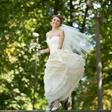 Young happy bride jumping. Stock Photo
