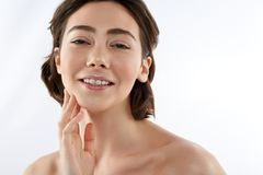 Young happy brunette female touching her chin royalty free stock photos