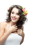 Young happy brunette girl. Portrait of young attractive caucasian brunette girl in white dress which happy smiling and holding her hands near chest royalty free stock images