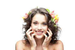 Young happy brunette girl. Portrait of young attractive caucasian brunette girl which happy smiling and holding her hands near face Stock Photo