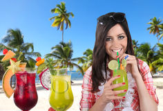 Young happy brunette girl with cocktails Royalty Free Stock Images