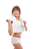 A young and happy brunette holding a dumbbell Stock Images