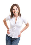A young and happy brunette woman in a white shirt Stock Photography