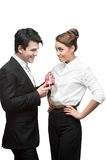 Young happy business people giving red gift Royalty Free Stock Images