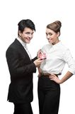 Young happy business people giving red gift Stock Photography