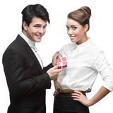 Young happy business people holding gift Stock Images