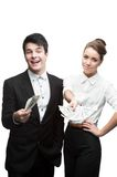 Young happy business people holding money Royalty Free Stock Image