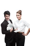 Young happy business people holding money Stock Photos
