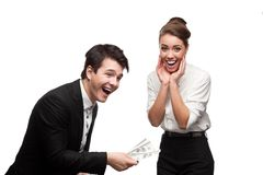Young happy business people holding money Stock Photography