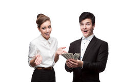 Young happy business people holding money Royalty Free Stock Photo