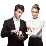 Young happy business people holding money Royalty Free Stock Images