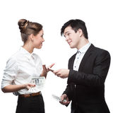 Young happy business people holding money Royalty Free Stock Photos