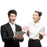 Young happy business people holding money Stock Image