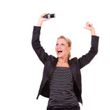 Young happy business woman. With mobile phone Royalty Free Stock Photos