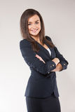 Young happy business woman with cross hands. Royalty Free Stock Images