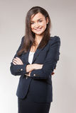 Young happy business woman with cross hands. Stock Images