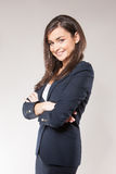 Young happy business woman with cross hands. Royalty Free Stock Photography
