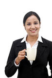 Young happy business woman with a cup of coffee Royalty Free Stock Images