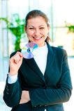 Young happy business woman holding compact disc. On blurred background office Royalty Free Stock Photo