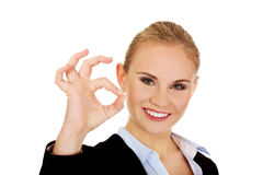 Young happy business woman shows OK sign Stock Images