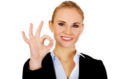 Young happy business woman shows OK sign Royalty Free Stock Image