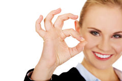 Young happy business woman shows OK sign Stock Image
